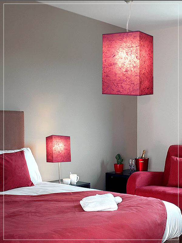 Pendant and Table Cube Lamp Shade in a bedroom.