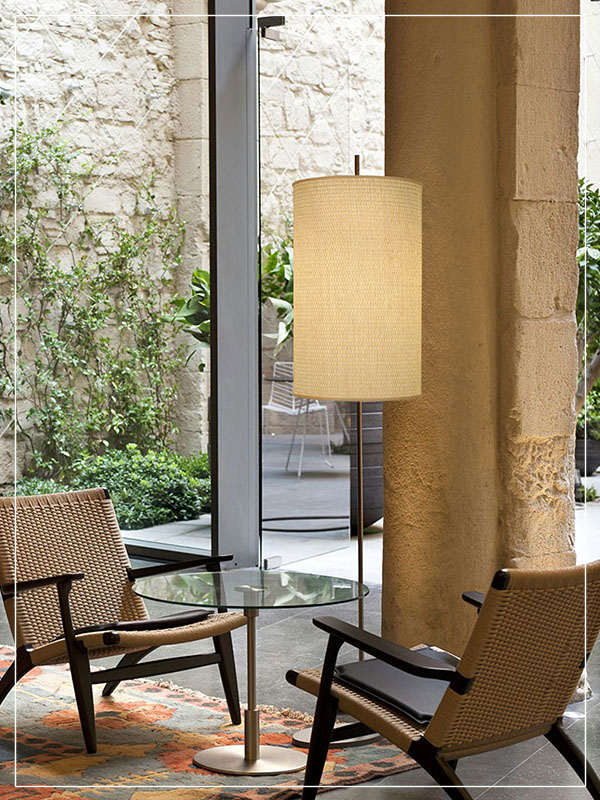 Cylindrical Floor Lamp made of Rattan in a house.