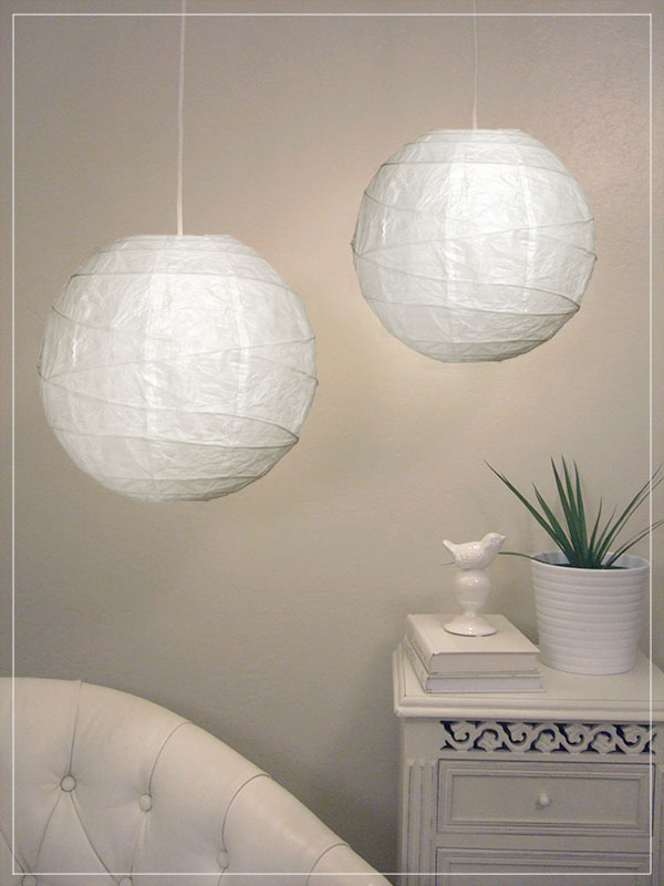 Pendant lantern in white in room.
