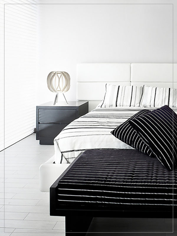 Modern Modular Table lamp shade Luna with tripod in a bedroom.