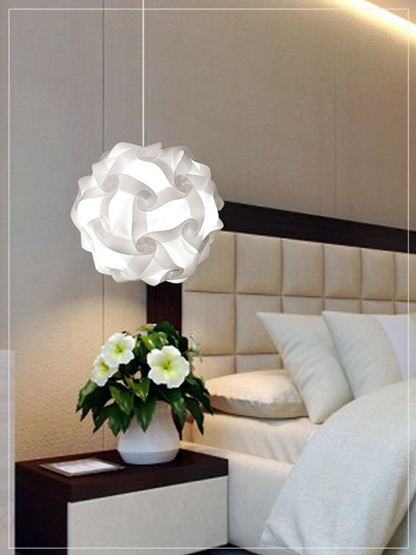 White Pendant Lamp Shade Flower Ball in a Bedroom.
