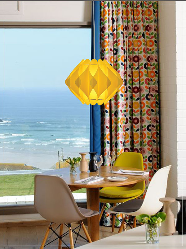 Contemporary Pendant Light Fixture Saporo in yellow in a house.