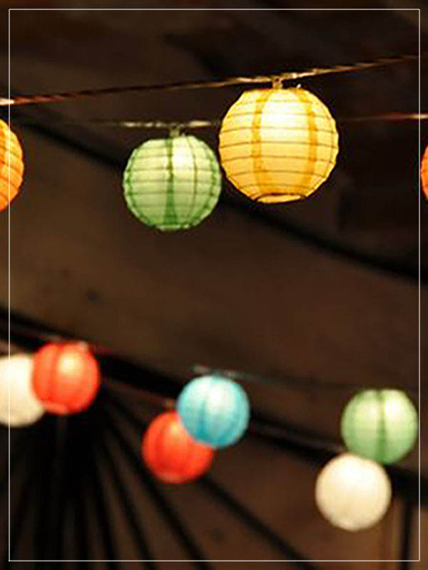 Garland with multicolor lanterns in an event.
