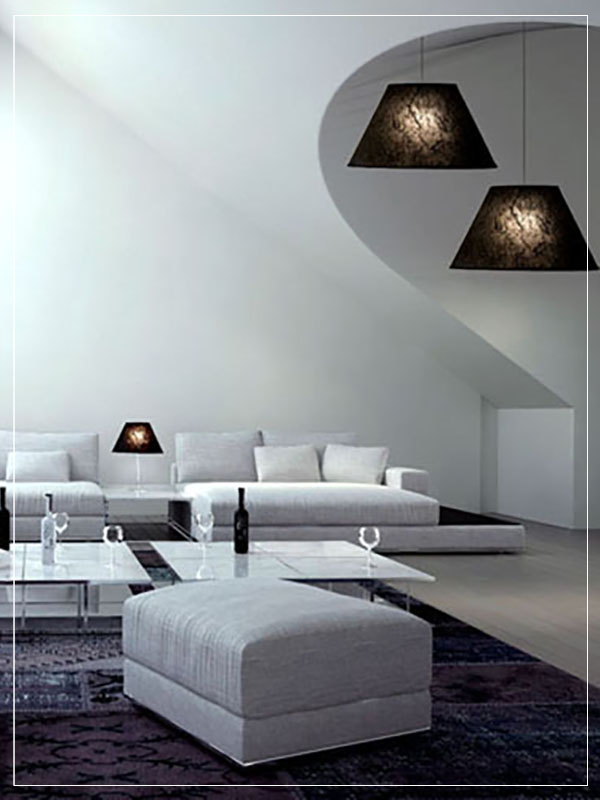 Pendant and Table Cone Lamp Shadε in a bedroom.