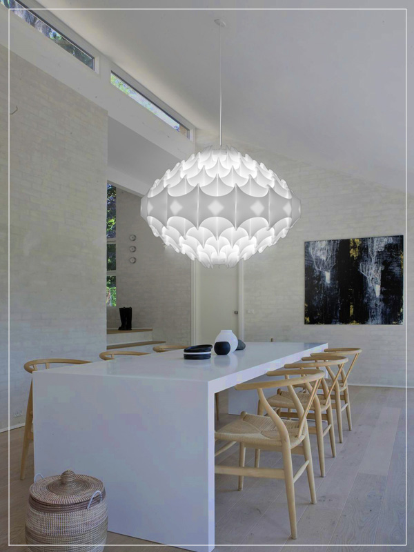 Contemporary Pendant Light Fixture Zenith in White in a Dining Room.