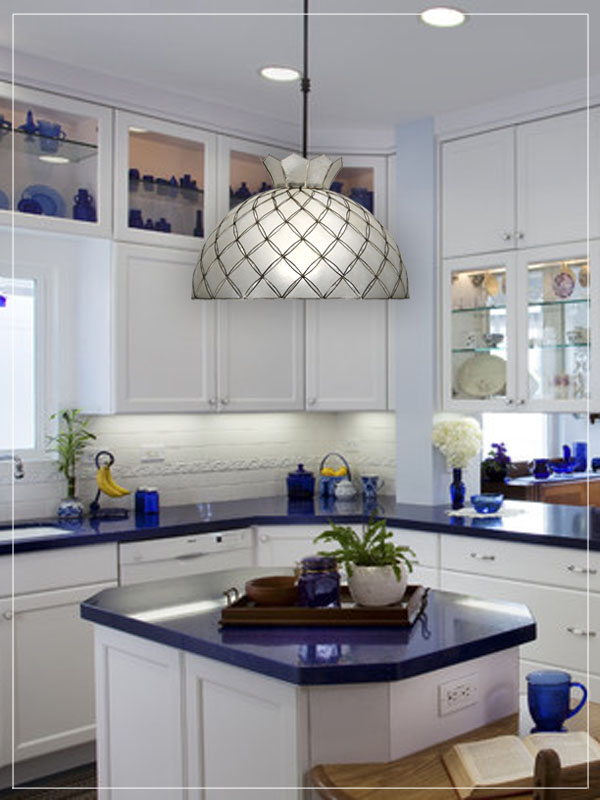 Pendant seashell lampshade in a kitchen.