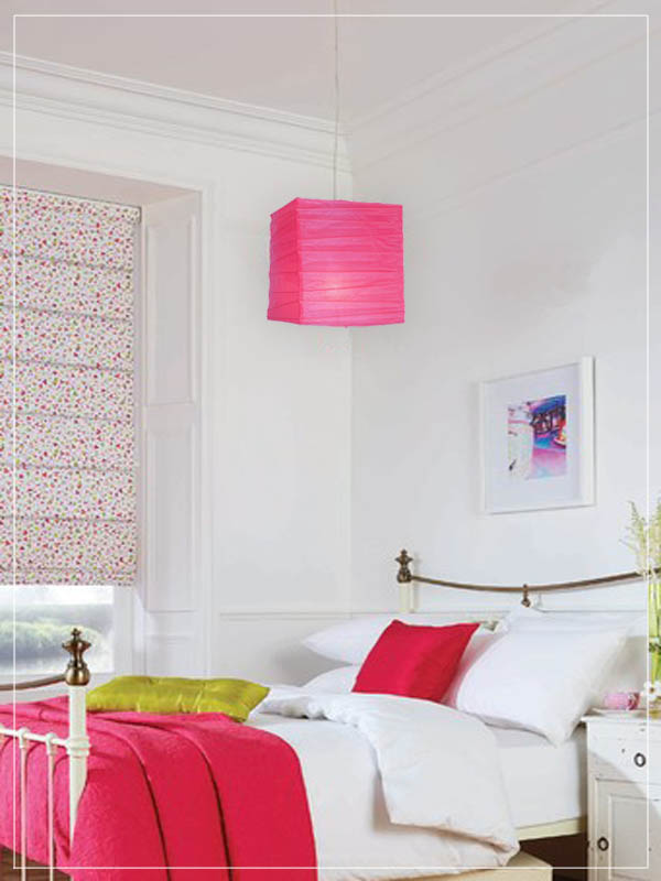 Pink square pendant lantern in a bedroom.