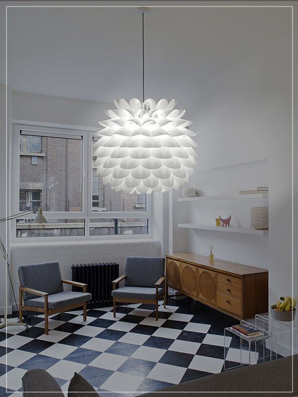 Modular Light Fixture Star in White in a Living Room.
