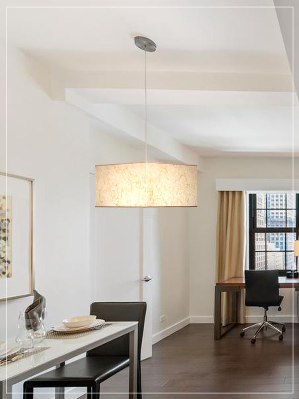Recantgle pendant lampshade in beige color in a living room.