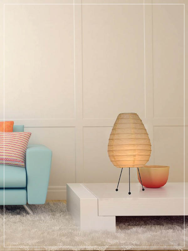 Egg shaped rice paper & baboo lamp in a living room.